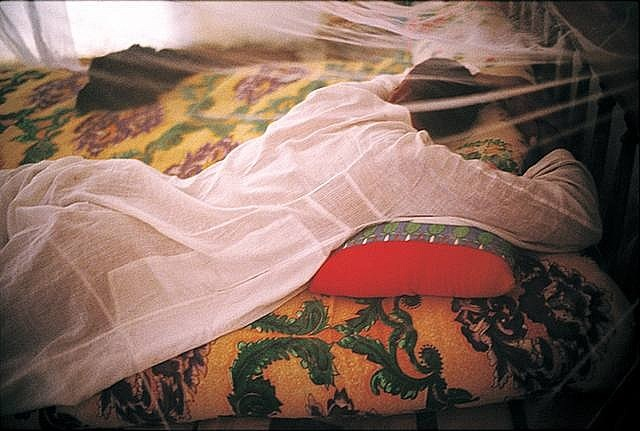 nan-goldin-jabalowe-under-his-mosquito-net,-barat,-luxor,-egypt